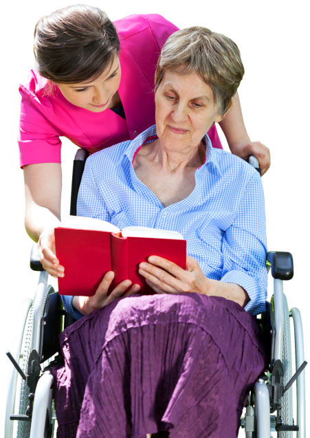 caregiver assisting senior woman to read a book