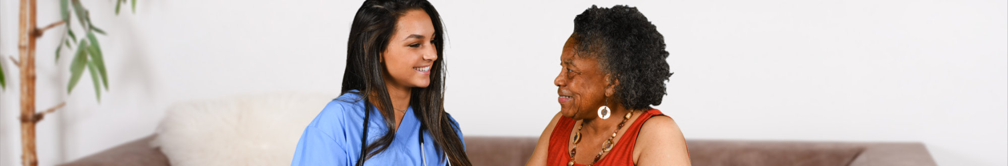 caregiver and a senior woman talking